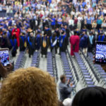 Graduates enter the Alfond Arena during the University of Maine's 215th Commencement in Orono.