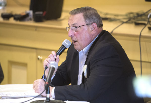 Seen speaking in East Millinocket against the Maine national monument last year, Gov. Paul LePage has ordered a ban of all monument signs along state roads until a federal review of the monument's status is finished.