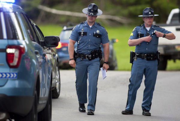 Maine State Police work to reconstruct the scene where a 1-year-old boy was fatally hit by a vehicle at Alton Elementary School Friday.