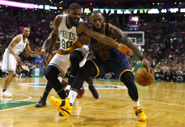 Boston Celtics forward Amir Johnson (left) tries to steal the ball from Cleveland Cavaliers forward LeBron James during the second half in game two of the Eastern conference finals of the NBA Playoffs at TD Garden in Boston on Friday night.