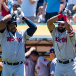 Boston Red Sox designated hitter Hanley Ramirez (13) celebrates with left fielder Chris Young (30) after a solo home run against the Oakland Athletics during the second inning of Saturday's game at Oakland Coliseum.