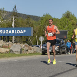 P.J. Gorneault (left) of Caribou and Judson Cake of Bar Harbor run side by side during Sunday's 35th Sugarloaf Marathon. Gorneault won the men's title for the second straight year.