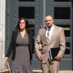 Michael Bryant and his wife Sarah Bryant exit the Portland federal courthouse, after he was sentenced to 3 years of probation for poaching more than $330,000 worth of baby eels, May 17, 2017.