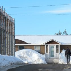 A worker walks toward the main office at Downeast Correctional Facility in Machiasport in February. The state prison will be closed in June, the state announced last week.