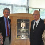Dr. Henry Ryan (third from left) is shown a dedication ceremony for a plaque installed in his honor at the state medical examiner's office in Augusta on Oct. 15, 2013, with (from left) former Chief Medical Examiner Dr. Margaret Greenwald, former Deputy Attorney General William Stokes and Attorney General Janet Mills.