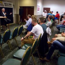 Hall of Fame Boston Globe sportswriter Bob Ryan (right) talks to fans at Sea Dog Brewing Company in Bangor Monday.