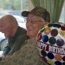 Tylor Kelly, right, shares a laugh with longtime friend Mike Kelly at Two Rivers Lunch where Tylor Kelly had his first-ever birthday party - at age 80 - on Wednesday. &quotI'll never turn 80 again,&quot Tylor Kelly said. &quotWhy not have a party?&quot