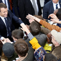 French President Emmanuel Macron shakes hands with people during a ceremony at the Arc de Triomphe after the handover ceremony in Paris, France, May 14, 2017.