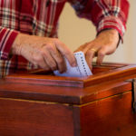 An Oxbow resident casts his ballot in Aroostook County at the community center.