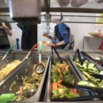 Middle School students get their lunch at the school cafeteria at Regional School Unit 3 in Thorndike. The school district collaborates with several area farms to source about 40 percent of the school's cafeteria food locally.