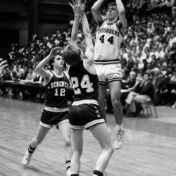 Matt Rossignol (44) of Van Buren scores over the defense of Bruce Blackstone (24) of Schenck of East Millinocket in Thursday's Eastern Maine Class B semifinal at the Bangor Auditorium in 1985.