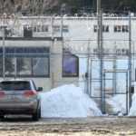 A car sits parked outside a security gate at the Downeast Correctional Facility in Machiasport last week. The state prison is again being proposed for closure as cost-saving measure in the proposed state budget.