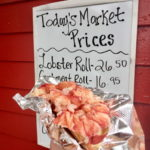 Due to demand overseas for Maine's crustacean, the price of Red's Eats famous lobster roll is at $26.50 this spring.