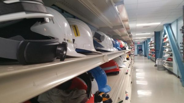 Hard hats line the wall at Point Lepreau. Lepreau executives say the facility has a laser focus on safety.