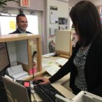 Madawaska Town Clerk Amy Ouellette is seen Tuesday processing a transaction for local resident Matt Russell at the Madawaska Town Office
