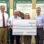 Retired Northern Maine Community College instructor Joseph McLauglin (second from left), and his wife Rebecca present a $10,000 donation to establish an endowed scholarship for students enrolled in the Computer and Network Technology program. Accepting the gift are President of NMCC, Timothy Crowley and the Chair of the NMCC Foundation, Gregg Collins.