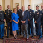 1st Sgt. Jeremiah Delisle, Army Spc. Joseph Smith, Army Sgt. Jared Smith, the Adjutant General, Brig. Gen. Douglas Farnham, Senior Airman Jordan Charpentier, Tech Sgt. Douglas Connolly, Master Sgt. Bryan Lord and 1st Lt. Adam Rodriguez stand with Gov. Paul LePage and First Lady Ann LePage after a joint recognition ceremony for the Outstanding Airman and Best Warrior of the Year.