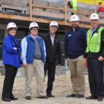 Meeting at the construction site for the new JCA home are Ellie Miller-Exec Director JCA, Jackie Parker-Patriot Subaru, Steve Brinn -Co-Chair JCA Capital Campaign Committee, Adam Arens-President Patriot Subaru, and Matt Rieders-Patriot Subaru.