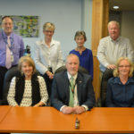 Members of the TAMC Board of Trustees met on May 4 at the Presque Isle hospital.  Those at the meeting included, seated from left:  new board members Scott Violette and Jane Towle; Steven St. Pierre, chair of the board; Carol Bell, vice chair; and Gene Lynch II, immediate past chair of the board and current chair of the finance committee. Other board members at the meeting were, standing from left: Richard Duncan, Dr. David Weed, Lynn Lombard, Holly Johnson, Barry McCrum and Dr. Sergio Lema.  Absent from the photo are: Alan Lundeen, Peter St. John, TAMC President Gregory LaFrancois, and Michelle Hood, president and CEO of EMHS.