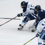 University of Maine's Nolan Vesey (left) tries to move the puck past New Hampshire's Dylan Maller during their hockey game at Alfond Arena in Orono on Dec. 3, 2016.