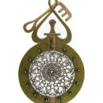 Maria Wolff's Viking Key (Strainer) features a stainless steel chainmail bowl supported by a pierced and textured bronze frame with garnet accents. Referencing Viking culture, this design would be well suited for the brave suitor who wishes to impress a shieldmaiden with this cocktail accoutrement.