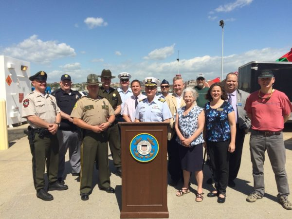Representatives from the U.S. Coast Guard, the National Weather Service and state boating law administrators from Maine, New Hampshire and Vermont are joined by local officials to show unity in promoting paddlecraft safety on May 19, in South Portland.
