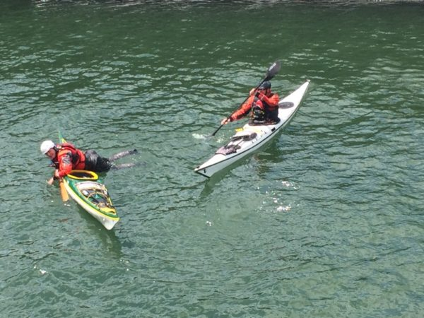 Humphrey Johnson and Ed Dox from the Maine Association of Sea Kayak Guides and Instructors perform self rescue techniques for the media on May 19, in South Portland, during an event focusing on paddling safety hosted by the U.S. Coast Guard.