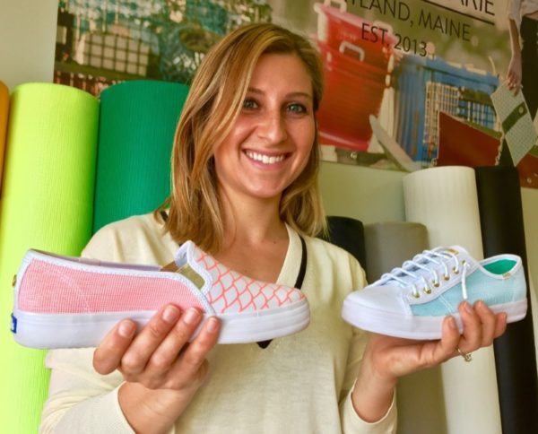 Alaina Marie Harris holds the sneakers she designed for Keds.