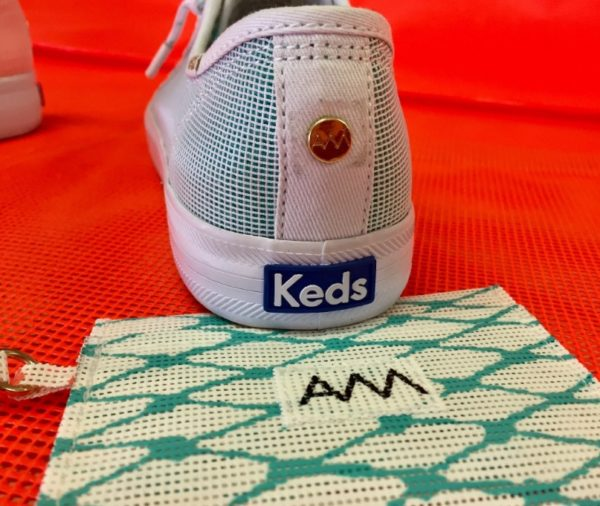 The new sneakers designed by Alaina Marie for Keds come with co-branding signature details like grommets.