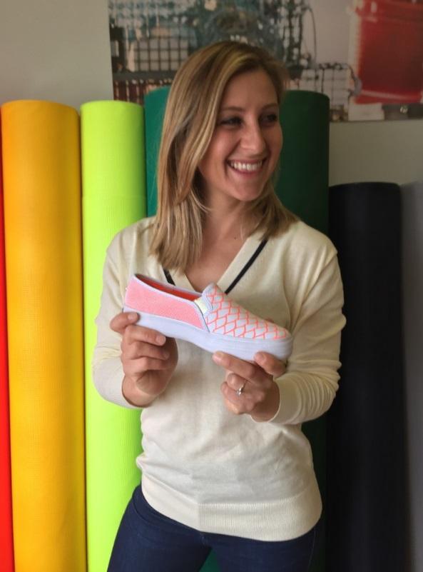 Alaina Marie Harris holds the sneaker she designed for Keds.