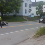 Bangor Police Department officers investigate the scene of a crash Tuesday evening.