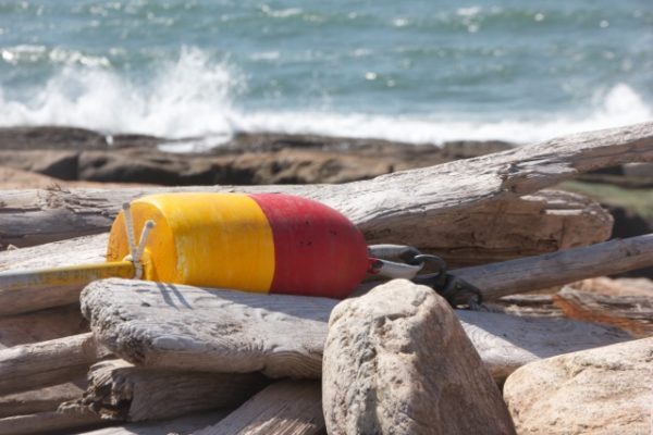 "This photo, called ""The Ruins,"" shows a lobster buoy stranded on the coast of Bear Cove in Steuben. It is among the images available at the show."