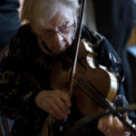 SOUTHWEST HARBOR, MAINE -- 05/02/2017 -- Ruth Grierson playes the violin at Sips Cafe in Southwest Harbor during a Monday evening open mike session. At the age of 89, Grierson maintains a busy schedule of playing her violin at various venues.