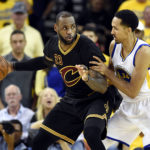 Cleveland Cavaliers forward LeBron James (23) handles the ball against Golden State Warriors guard Shaun Livingston (34) during the third quarter in game seven of the NBA Finals at Oracle Arena.