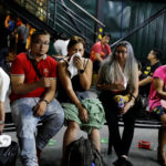 Tourists are pictured after being evacuated from a Resorts World building in Pasay City, Metro Manila, Philippines on June 2, 2017.