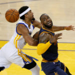 Cleveland Cavaliers forward LeBron James (23) loses the ball while defended by Golden State Warriors forward James Michael McAdoo (20) in the first half of the NBA Finals at Oracle Arena on Thursday night.