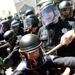 Police in riot gear hold back demonstrators against U.S. Republican presidential candidate Donald Trump outside the Hyatt hotel where Trump is set to speak at the California GOP convention in Burlingame, California, U.S., April 29, 2016.