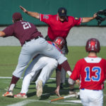 Motor City's Jackson Coutts (second from left) is called safe at home past Brewer's Matt Pushard (left) during a 2015 American Legion baseball game at Husson University in Bangor.