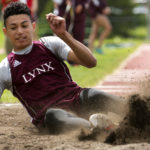 Mattanawcook Academy's Cayden Spencer-Thompson lands in the dirt after competing in the triple jump during the State Class C Track and Field Championship Meet at Foxcroft Academy in Dover-Foxcroft Saturday. Spencer-Thompson placed first in the event and set a new state record.