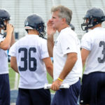 Former University of Maine head football coach Jack Cosgrove (center), now the school's senior associate director of athletics, is chairing the search committee for a new head baseball coach at UMaine.