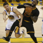 Golden State's Klay Thompson (left) fouls Cleveland's LeBron James in the third quarter of Game 2 of the NBA Finals on Sunday at Oracle Arena in Oakland, California.