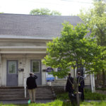 Members of the defense and prosecution take a site tour of 201 Center Street in Bangor on May 24.