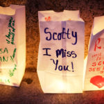 Lighted paper bags stand as memorials to those lost at a drug overdose victims' vigil in Portland's Monument Square, Aug. 31, 2015.