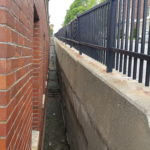 A retaining wall behind Bangor City Hall. City officials plan to renovate the deteriorating wall over the summer.
