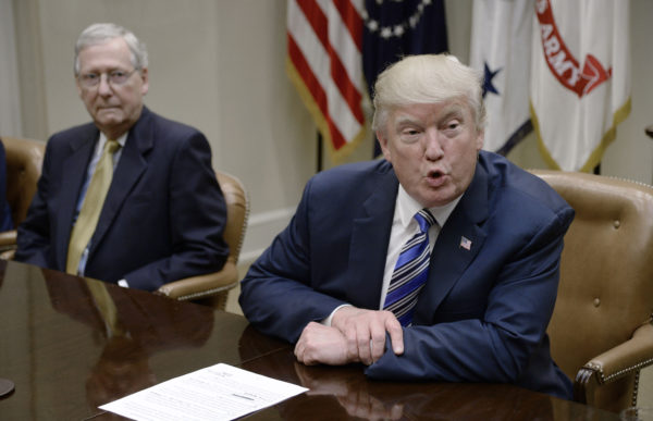 President Donald Trump speaks as Senate Majority Leader Mitch McConnell looks on during a meeting with House and Senate leadership on June 6, 2017, in the Roosevelt Room of the White House in Washington, D.C.