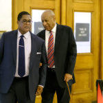With assistance from his aide, Bill Cosby arrives for day three of his sexual assault trial on Wednesday, June 7, 2017 at the Montgomery County Courthouse in Norristown, Pennsylvania.