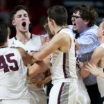 Jarrod Chase (second left) of George Stevens Academy is mobbed by his teammates after hitting the game-winning shot in the Class C state championship game in March at the Cross Insurance Center in Bangor. Chase has committed to attend Husson University in Bangor.
