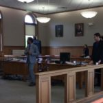 Reginald Dobbins (far right_ stands with his attorney, Hunter Tzovarras of Bangor, in Aroostook County Superior Court in Houlton on Monday, June 5, 2017. Dobbins is accused of killing Keith Suitter, 61, of Houlton two years ago.