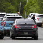 Maine State Police, Penobscot County Sheriff, and Brewer police work on the scene where 54-year-old Mark Ellis was killed after more than a 12 hour standoff with police at his home in Orrington on Wednesday.