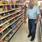 MAPLETON, Maine -- 06/07/17 -- On Wednesday, Tom Mastro, co-owner of the Mapleton One Stop, points to a spot on the floor where a customer started losing blood from a surgical wound and lost consciousness on Monday. Mastro